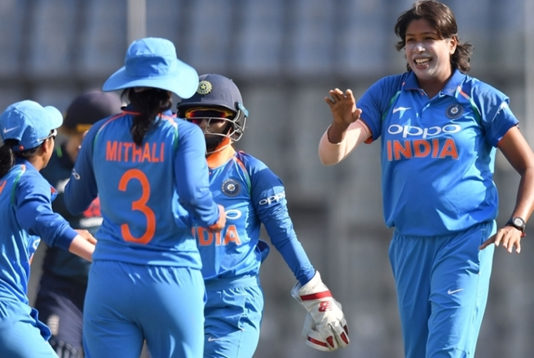 Jhulan Goswami (R) celebrates with teammates after taking the wicket of England's captain Heather Knight during the second match of the women's ODI series. Photo by PUNIT PARANJPE / AFP