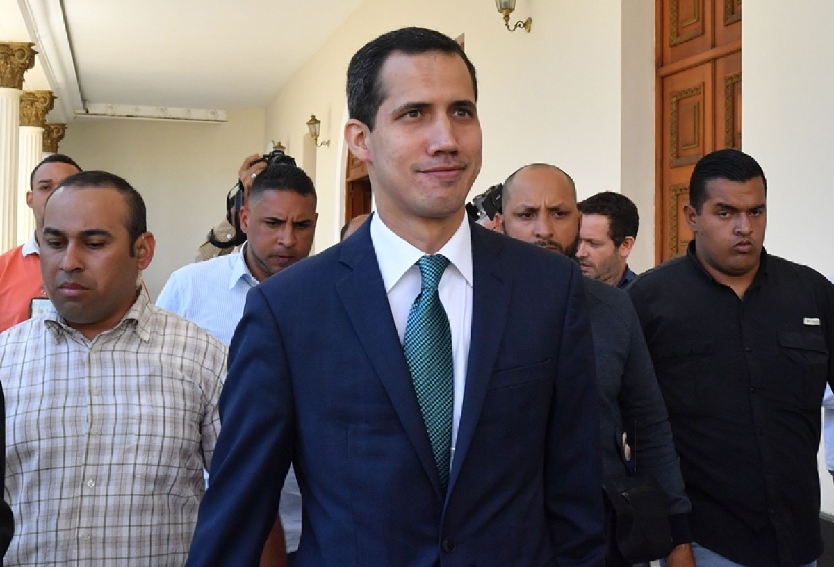 Venezuela's opposition leader and self-proclaimed acting president Juan Guaido (C) arrives at the Federal Legislative Palace, which houses both the National Assembly and the National Constitutional Assembly. Photo by Yuri CORTEZ / AFP
