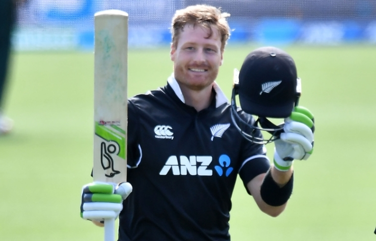 Martin Guptill celebrates 100 runs during the second one-day international  cricket match between New Zealand and Bangladesh. Photo by Marty MELVILLE / AFP