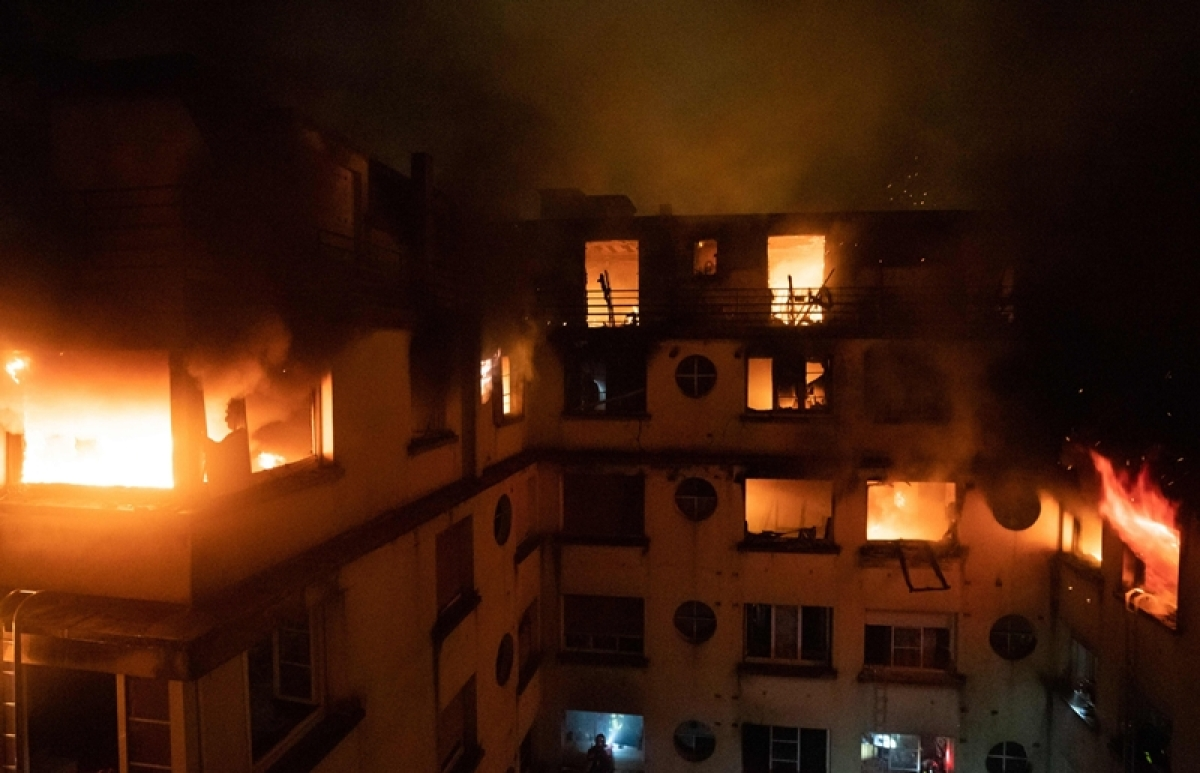 This handout picture taken and released by the Paris firefighters brigade (BSPP) in the night of February 5, 2019 shows a fire in a building in Erlanger street in the 16th arrondissement in Paris. Photo by Benoît Moser / BSPP - Brigade de sapeurs-pompiers de Paris / AFP