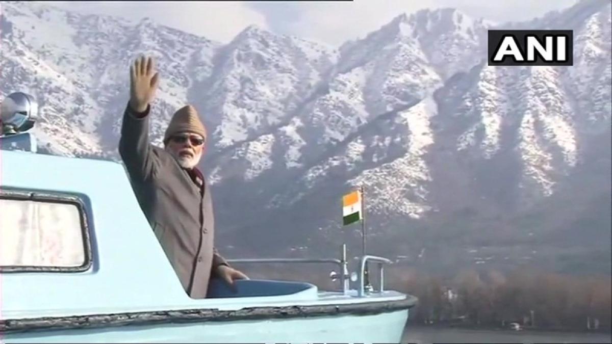 PM Narendra Modi waves at 'imaginary friends' during his boat ride in Dal Lake?
