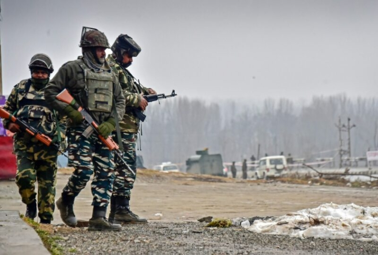 Lethpora: Security personnel inspect the site of suicide bomb attack at Lethpora area, in Pulwama district of south Kashmir, Friday, Feb. 15, 2019. At least 37 CRPF personnel were killed yesterday in one of the deadliest terror attacks in Jammu and Kashmir when a Jaish suicide bomber rammed a vehicle carrying over 100 kg of explosives into their bus in Pulwama district. (PTI Photo/S Irfan)(PTI2_15_2019_000031B)