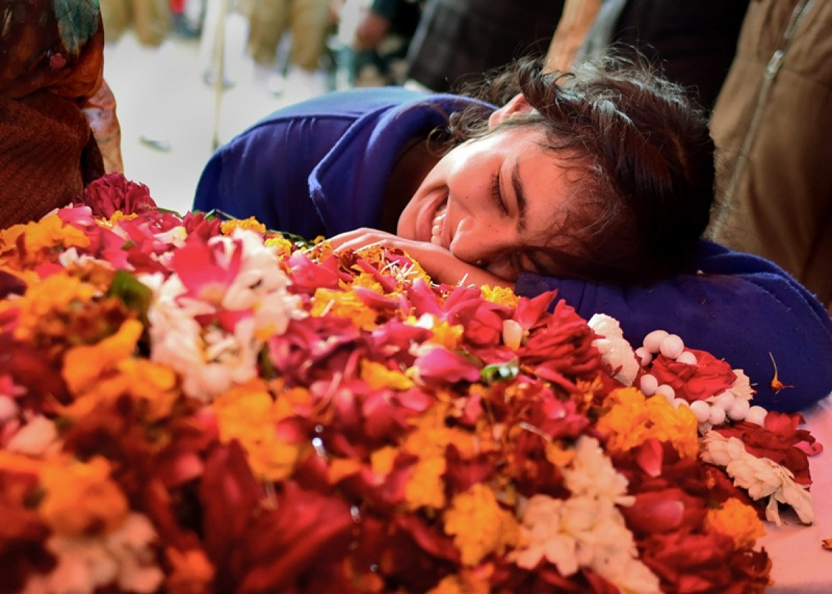 Allahabad: A family member of slain CRPF Mahesh Yadav cries before his funeral at Tudihar, in Allahabad district, Saturday, Feb. 16, 2019. Yadav lost his life in Pulwama terror attack. (PTI Photo) (PTI2_16_2019_000133B)