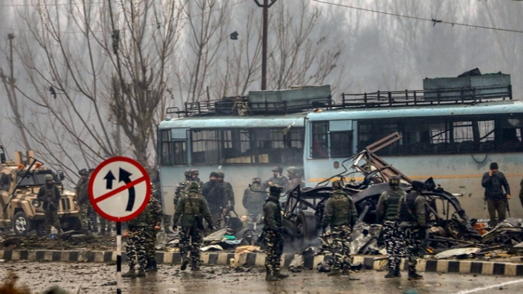 Security personnel carry out the rescue and relief works at the site of suicide bomb attack at Lathepora Awantipora in Pulwama.