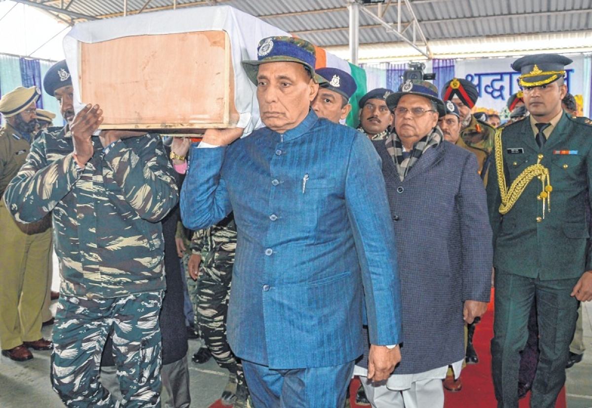 Rajnath Singh shoulders a coffin