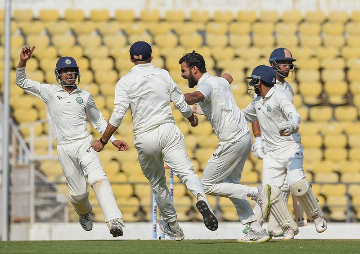 Nagpur: Vidarbha team members celebrate the dismissal of Saurashtra's Cheteshwar Pujara during the Vidarbha-Saurashtra Ranji Final cricket match, in Nagpur, Monday, Feb 4, 2019. (PTI Photo/Shirish Shete) (PTI2_4_2019_000192B)