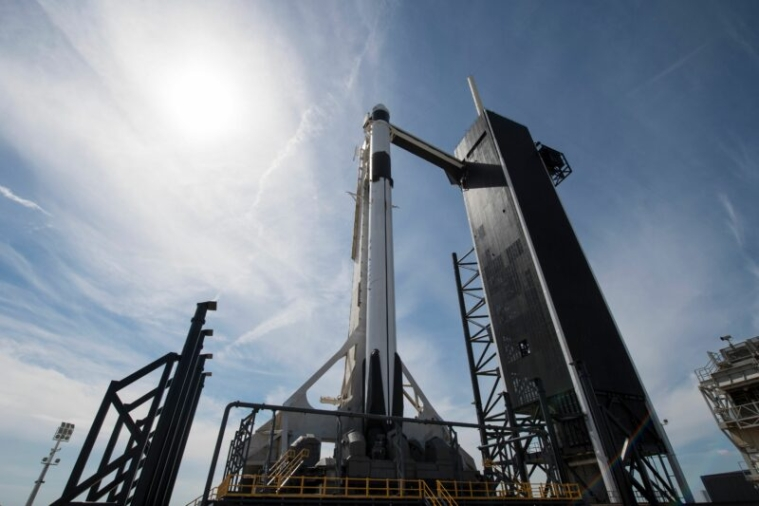 "This handout photo released  NASA shows a SpaceX Falcon 9 rocket with the company's Crew Dragon spacecraft onboard is seen seen on the launch pad at Launch Complex 39A  as preparations continue for the Demo-1 mission on March 1, 2019 at the Kennedy Space Center in Florida. - The Demo-1 mission will be the first launch of a commercially built and operated American spacecraft and space system designed for humans as part of NASA's Commercial Crew Program. The mission, currently targeted for a 2:49am launch on March 2, will serve as an end-to-end test of the system's capabilities. (Photo by Joel KOWSKY / NASA / AFP) / -----EDITORS NOTE --- RESTRICTED TO EDITORIAL USE - MANDATORY CREDIT ""AFP PHOTO / NASA / JOEL KOWSKY "" - NO MARKETING - NO ADVERTISING CAMPAIGNS - DISTRIBUTED AS A SERVICE TO CLIENTS"