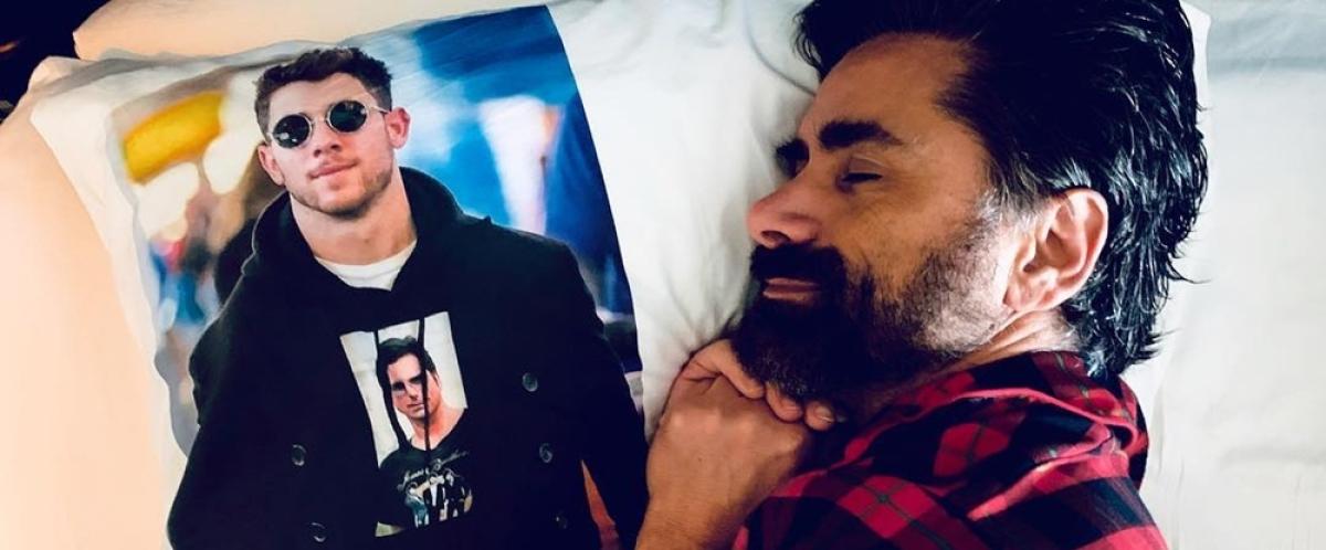 John Stamos gets a Nick Jonas tattoo