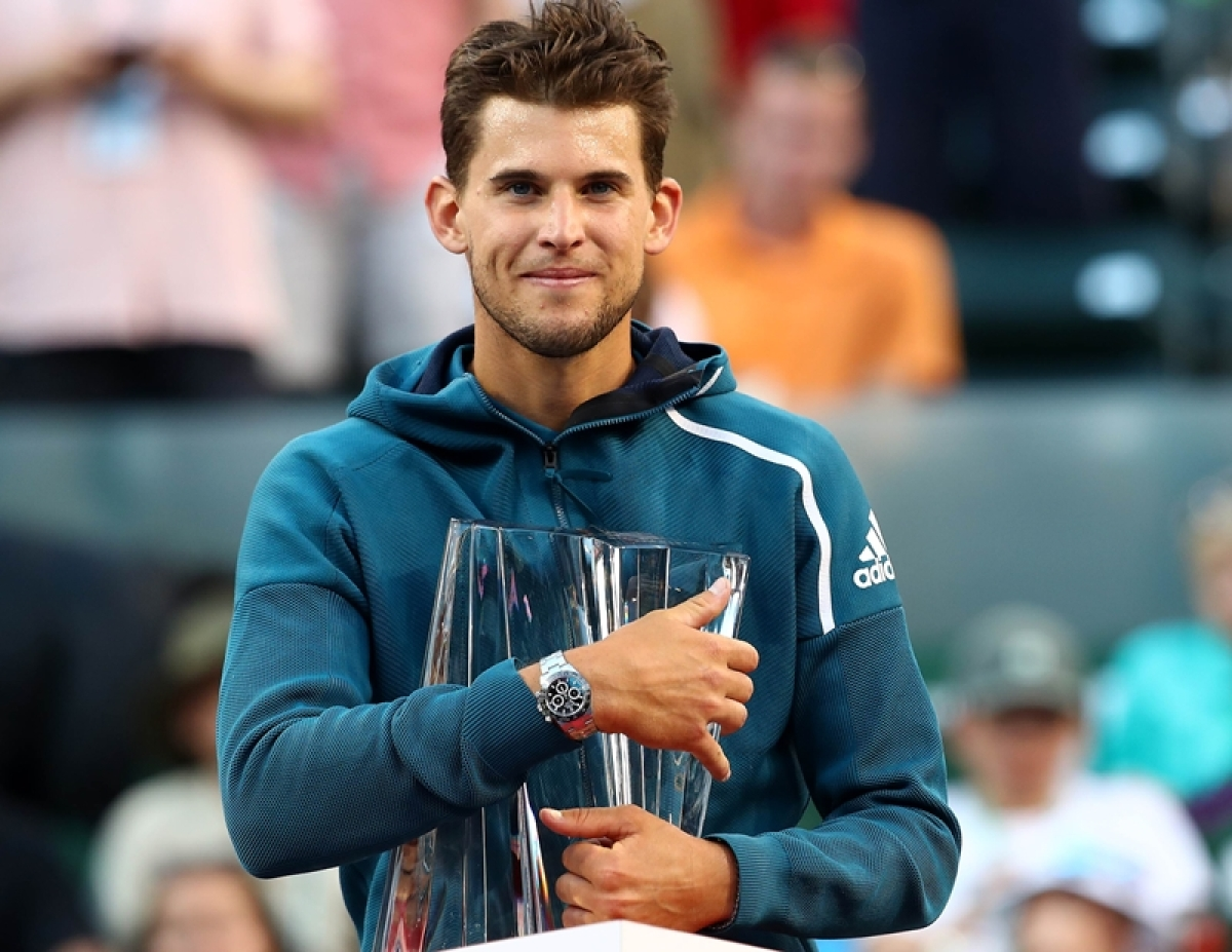 Dominic Thiem holds the championship trophy after his men's singles final victory against Roger Federer on day fourteen of the BNP Paribas Open at the Indian Wells.   Clive Brunskill/Getty Images/AFP