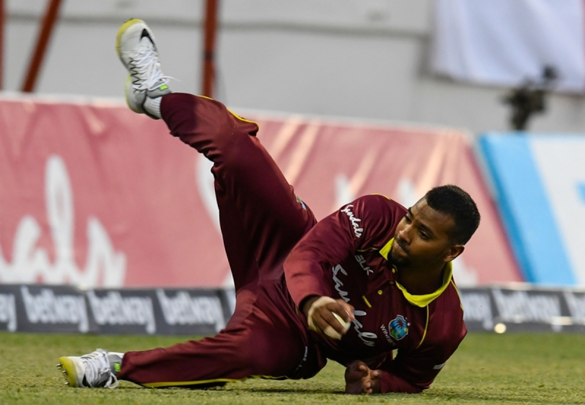 Nicholas Pooran fields a ball during a T20 match between the West Indies and England. Photo by Randy Brooks / AFP