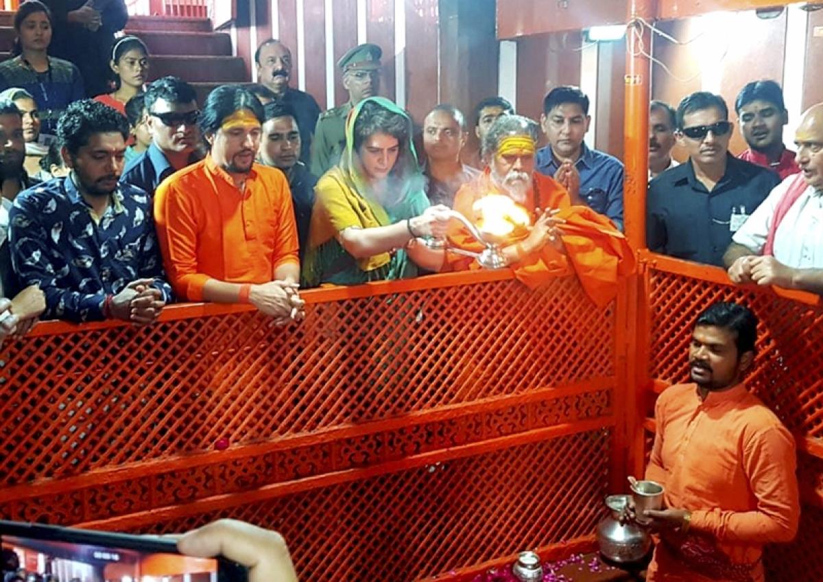 Congress General Secretary UP-East Priyanka Gandhi Vadra offers prayers at Bade Hanuman temple in Prayagraj. PTI Photo