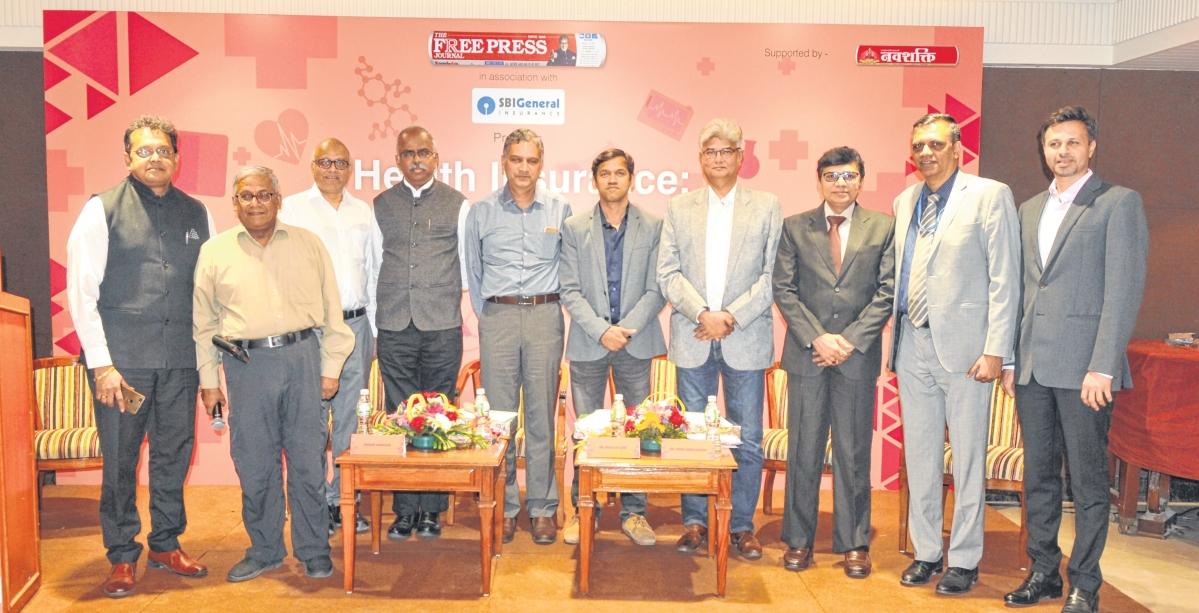 Left to right: Nikhil Apte, Chief Product Officer, Royal Sundaram General Insurance Co Ltd; R N Bhaskar, Consulting Editor; Ashok Karnani, Director, Free Press Journal; A Velumani, Founder & CMD, Thyrocare Ltd; Madan Sabnavis, Chief Economist, CARE Ratings Ltd; Dr Rohit Sane, MD & CEO, Madhavbaug; Dr. Hiren Ambegaonkar, CEO, S L Raheja Hospital; Pravin Swamy, CEO, Godrej Hospital; Bhaskar Nerurkar, Head, Health Administration Team, Bajaj Allianz General Insurance Co Ltd and Abhishek Karnani, Director, Free Press Journal after the panel discussion.