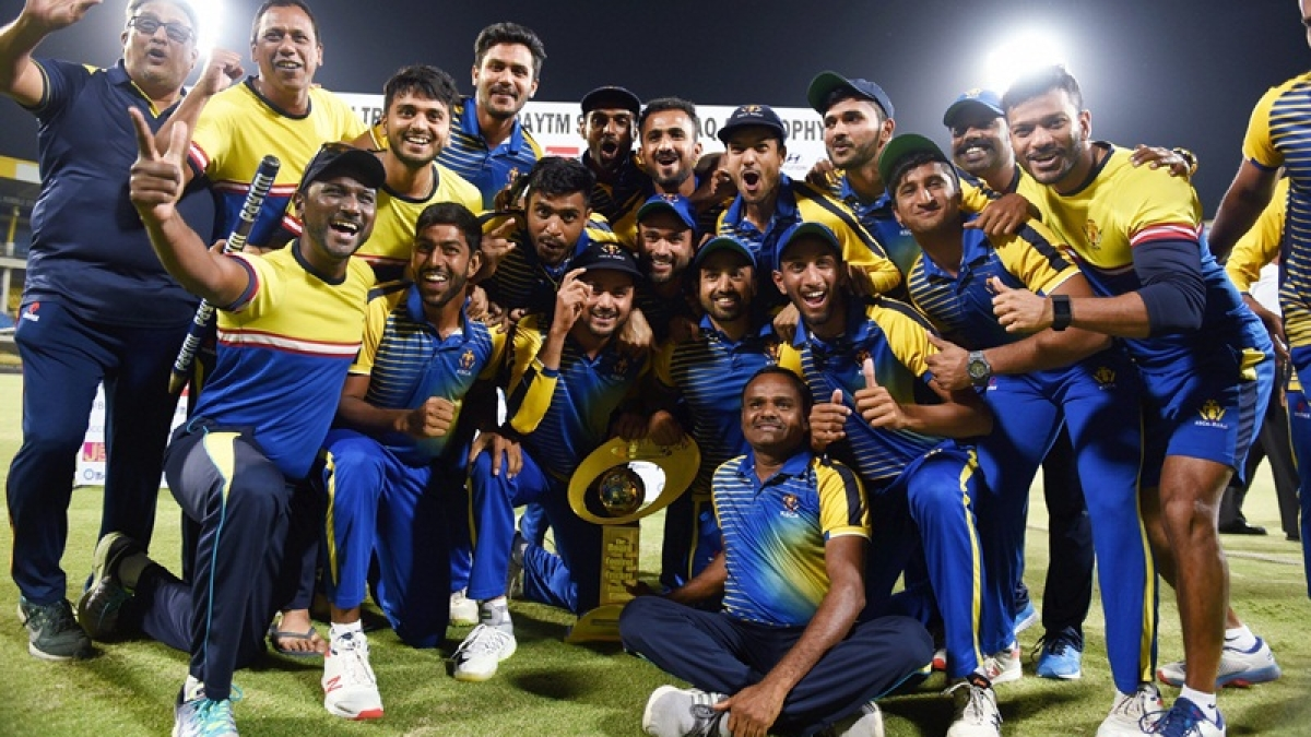 Indore: Karnataka players pose with a trophy after wining the Syed Mushtaq Ali Trophy cricket tournament, in Indore, Thursday, March 14, 2019. (PTI Photo)