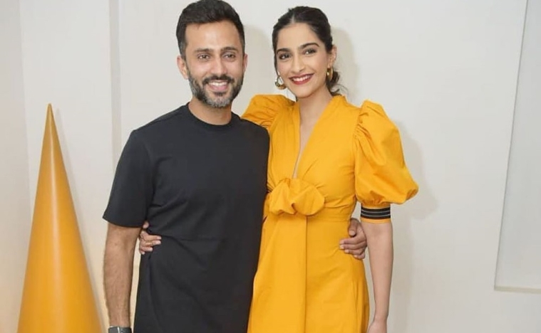 Anand Ahuja tying Sonam Kapoor's lace, down on one knee, is giving out major husband goals