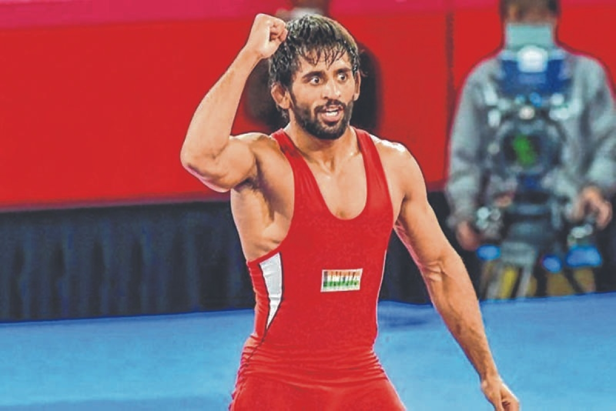 World number one Bajrang Punia logged 10 points in a row in the gold medal bout to reclaim his Asian Championship crown, defeating Kazakhstan's Sayatbek Okassov 12-7 in a nail-biting 65kg men's free style final here Tuesday.
