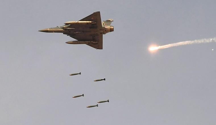 "In this photo taken on February 16, 2019, an Indian Air Force (IAF) Mirage-2000 fighter aircraft drops bombs during the 'Vayu Shakti 2019' fire power demonstration at the IAF's firing range field in Pokhran in the state of Rajasthan. - An Indian air strike across the Kashmir ceasefire line early February 26 ""completely destroyed"" a militant camp, a junior minister said. (Photo by Prakash SINGH / AFP)"