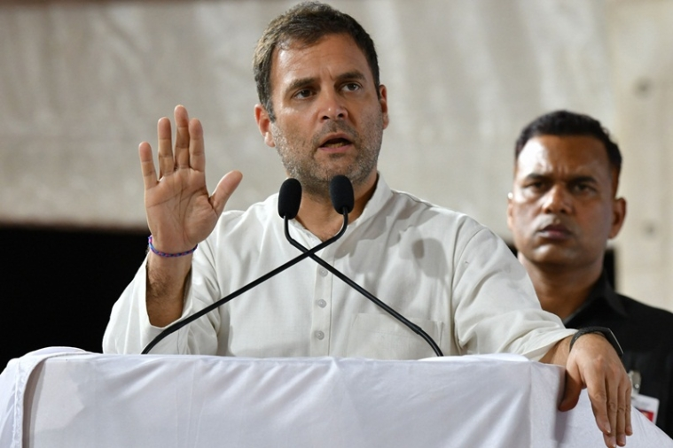 President of Indian National Congress (INC) Rahul Gandhi speaks during an election campaign rally at Krishnaraja Nagar, some about 200 Kms South West of Bangalore on April 13, 2019. - India's gargantuan election, the biggest in history, kicked off on April 11 with Prime Minister Narendra Modi seeking a second term from the South Asian behemoth's 900 million voters. (Photo by MANJUNATH KIRAN / AFP)