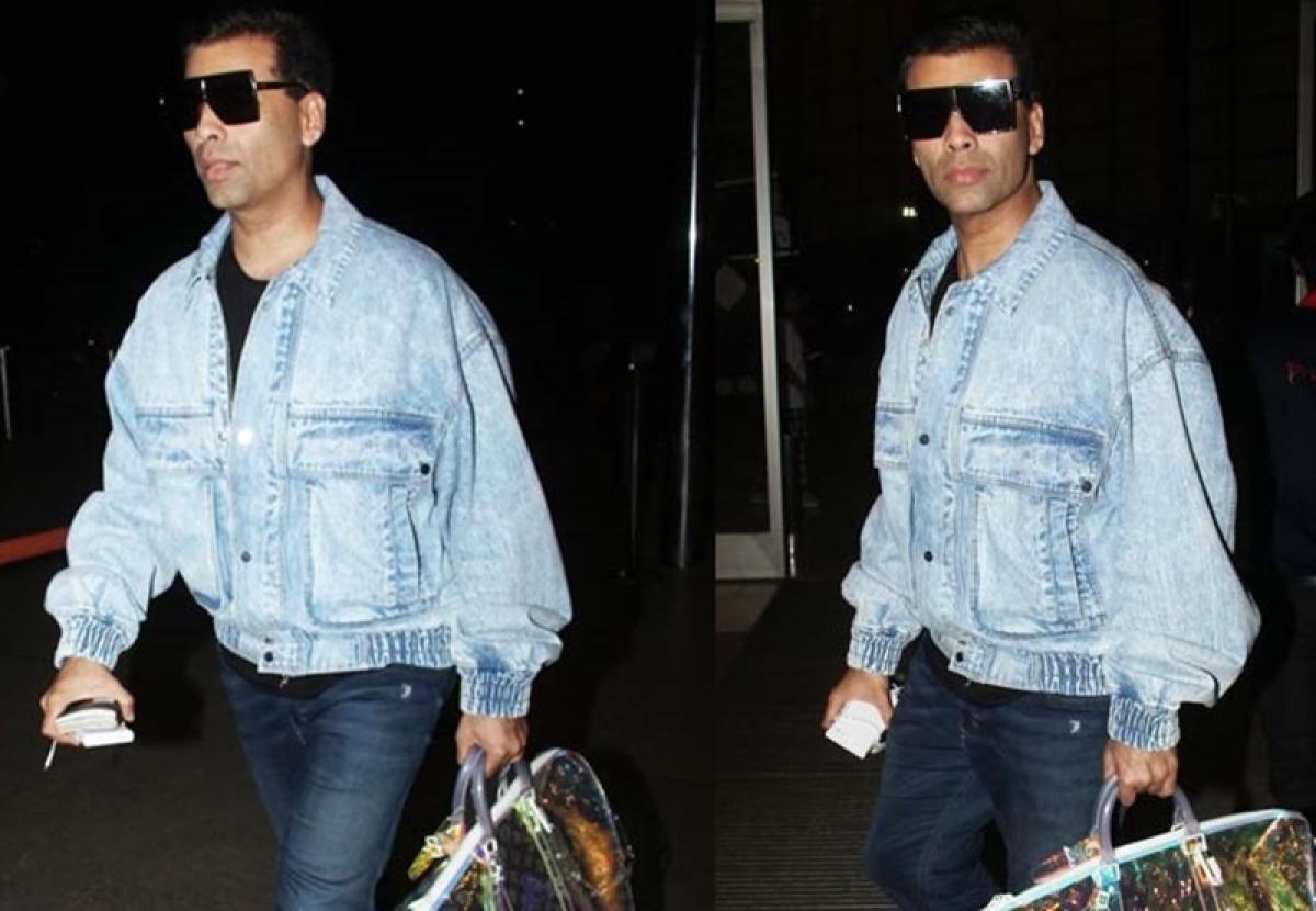 Karan Johar sports a colour changing bag that costs more than Rs 7 Lakh!