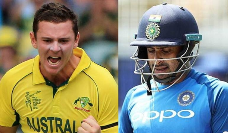 Josh Hazlewood of Australia and Ambati Rayudu of India.