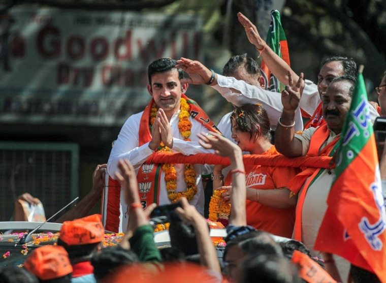 New Delhi: Former cricketer and BJP candidate from East Delhi Gautam Gambhir greets his supporters during an election roadshow for Lok Sabha elections, in New Delhi, Saturday, April 27, 2019. (PTI Photo) (PTI4_27_2019_000016B)