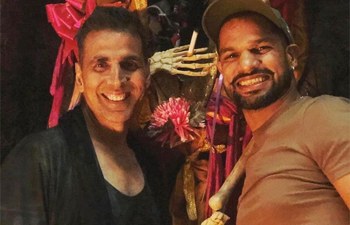 Akshay Kumar receives a surprise visit from cricketer Shikhar Dhawan on sets of 'Housefull 4'; shares pic on social media