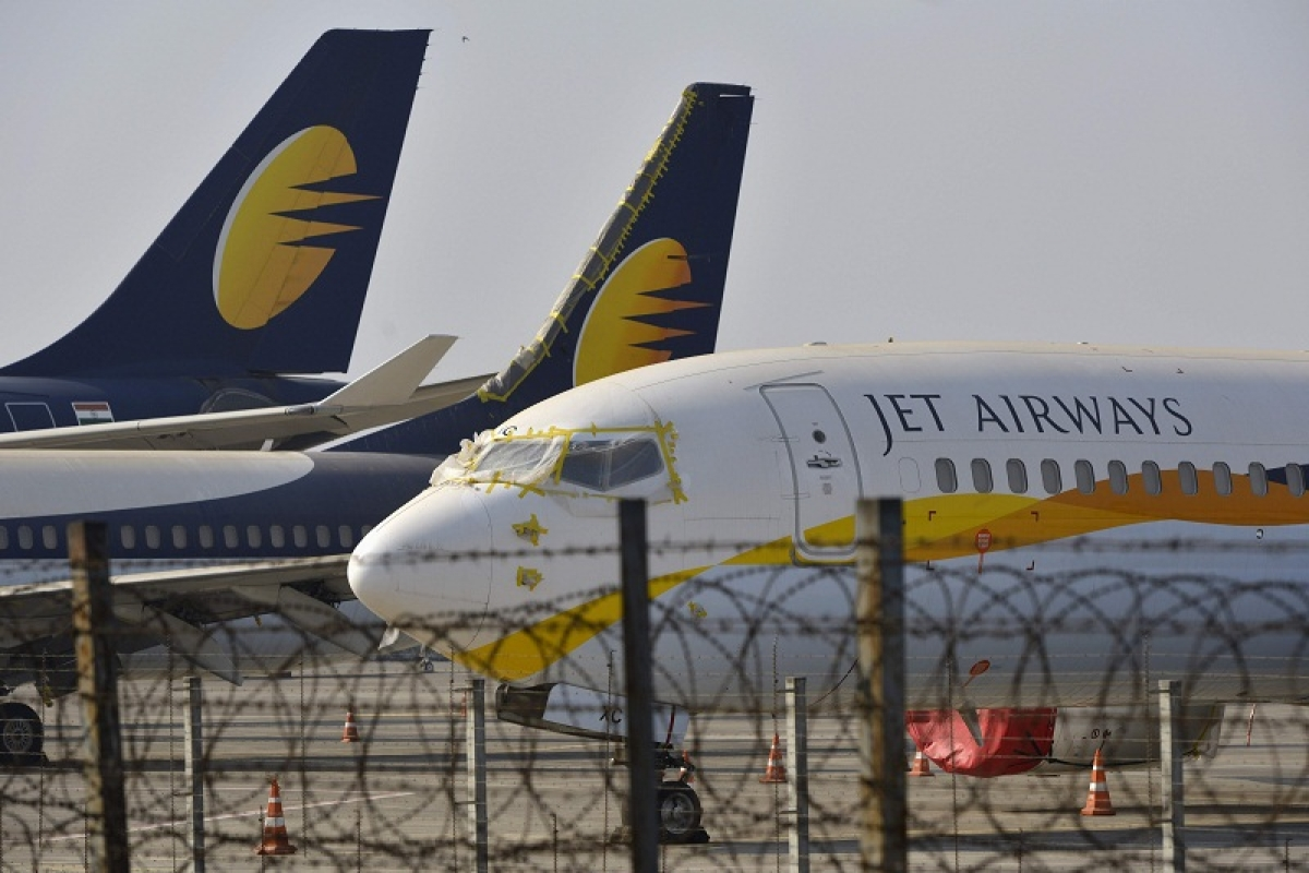 Jet Airways aircraft are seen parked on the tarmac at Chattrapati Shivaji International Airport in Mumbai on March 25, 2019. - India's troubled Jet Airways said on March 25 that founder Naresh Goyal has stepped down as chairman and left the company board as part of a rescue plan. (Photo by PUNIT PARANJPE / AFP)
