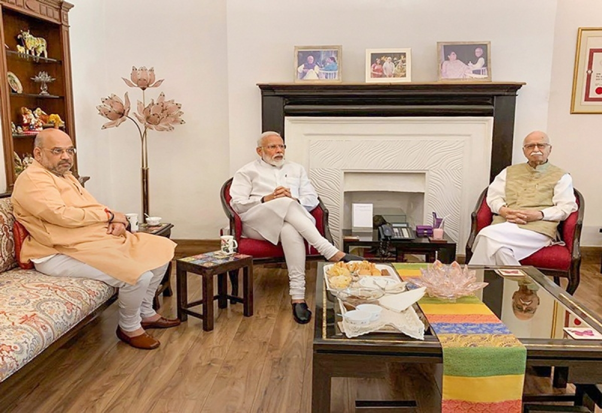 New Delhi: Prime Minister Narendra Modi and BJP President Amit Shah meet party's senior leader LK Advani after their victory in the Lok Sabha elections, in New Delhi, Friday, May 24, 2019. (PTI Photo)  (PTI5_24_2019_000025B)