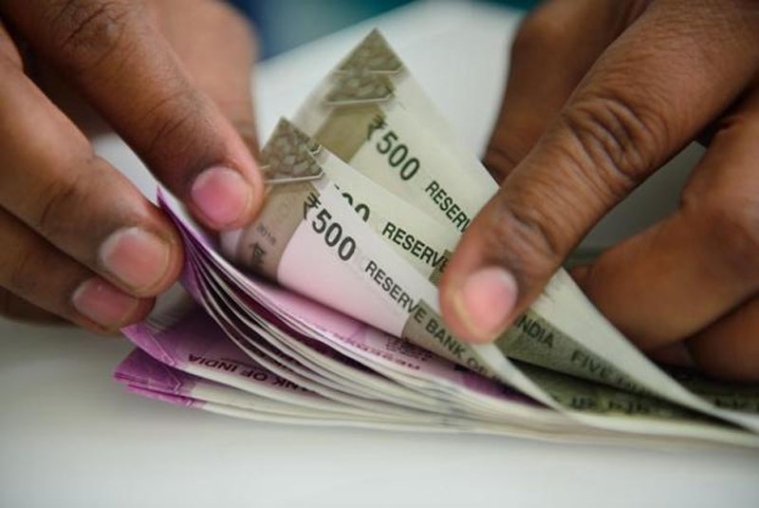 Rupee slips 13 paise to 70.07 against USD in early trade