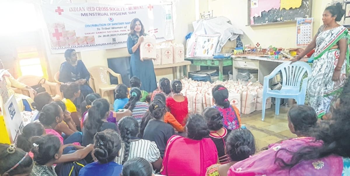 IRCS distributes hampers, sanitary napkins to tribals