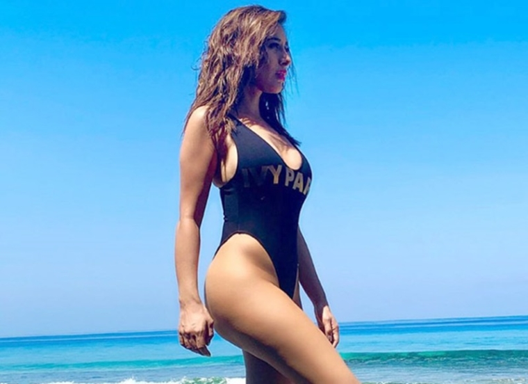 Sophie Choudry flaunts her curves at the beach in a black swim suit