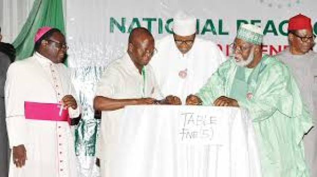 President Muhammadu Buhari signing the peace accord agreement