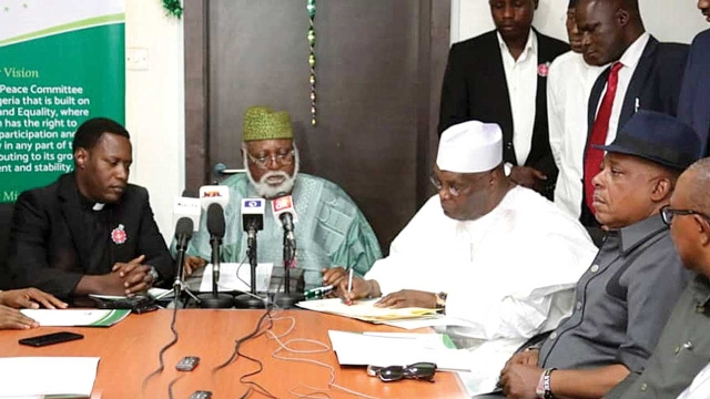 Atiku   Abubakar signing the peace accord agreement