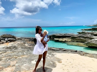 Former Miss World, Agbani, Gives Special Treat To Son At The  Beach