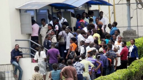 ATM users waiting for their turn on a queue outside a bank in Lagos