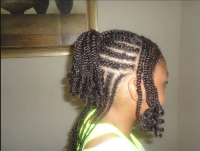 Evelyn King hairstyle plaited with hair attachments.