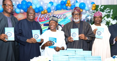 The celebrant, Akeredolu and Sam Amuka at the ceremony