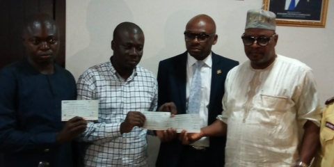 Folashade's family receiving cheque from state officials