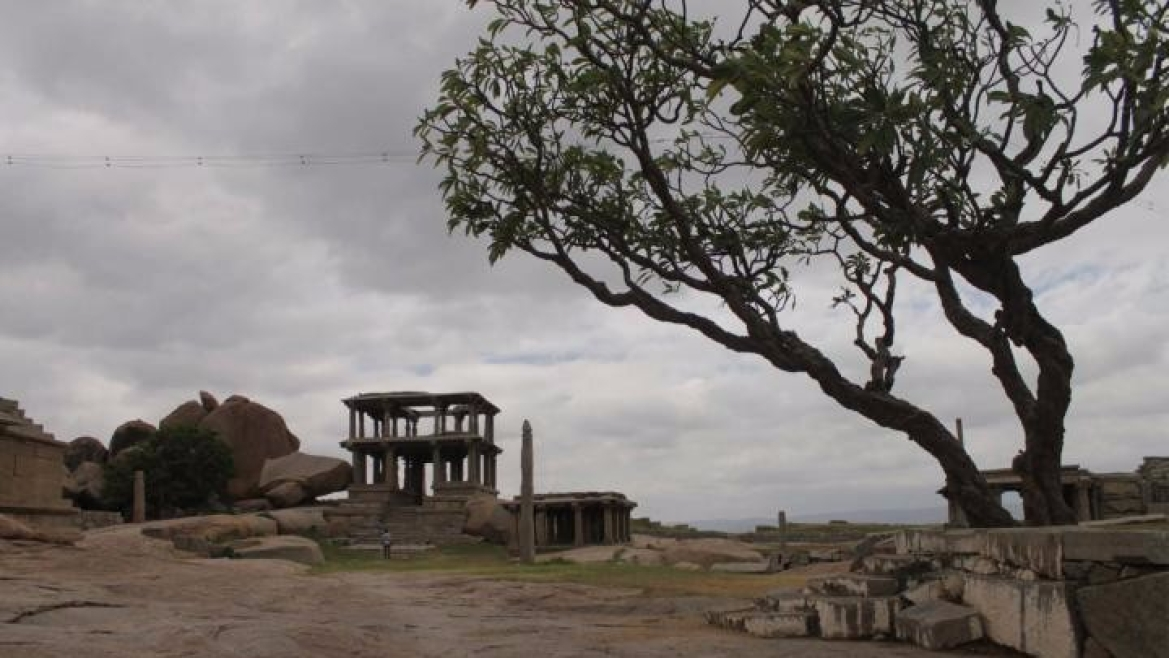 At the Hemakuta hills that look over the ruins of Hampi on one side, Virupaksha temple on the other.