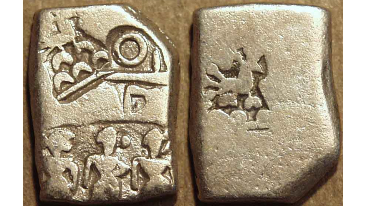 Rectangular coin chipped from one side to adjust the weight
