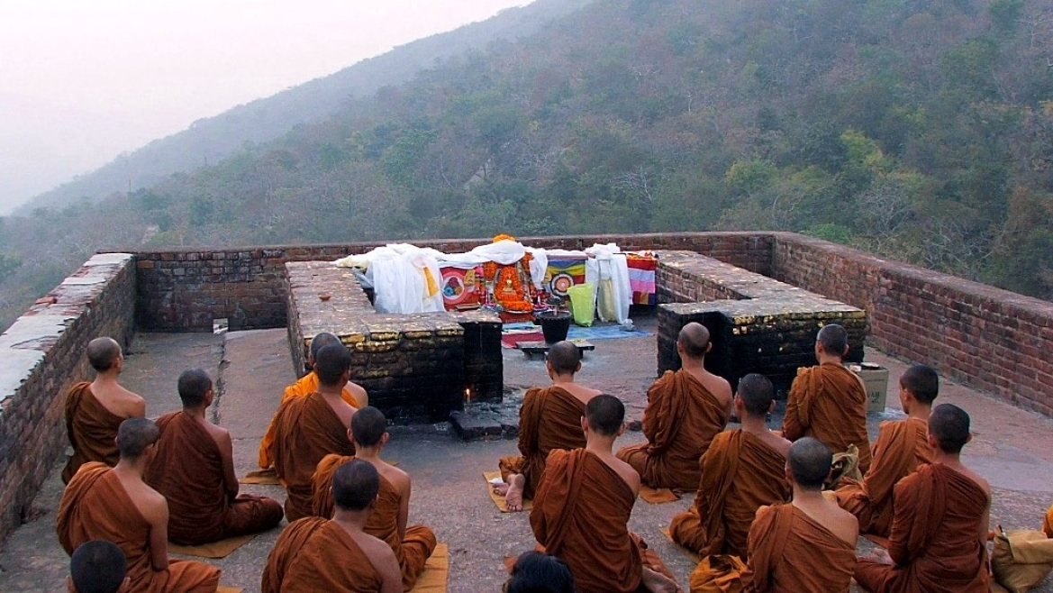 Buddhist monks meditating at Vulture's Peak