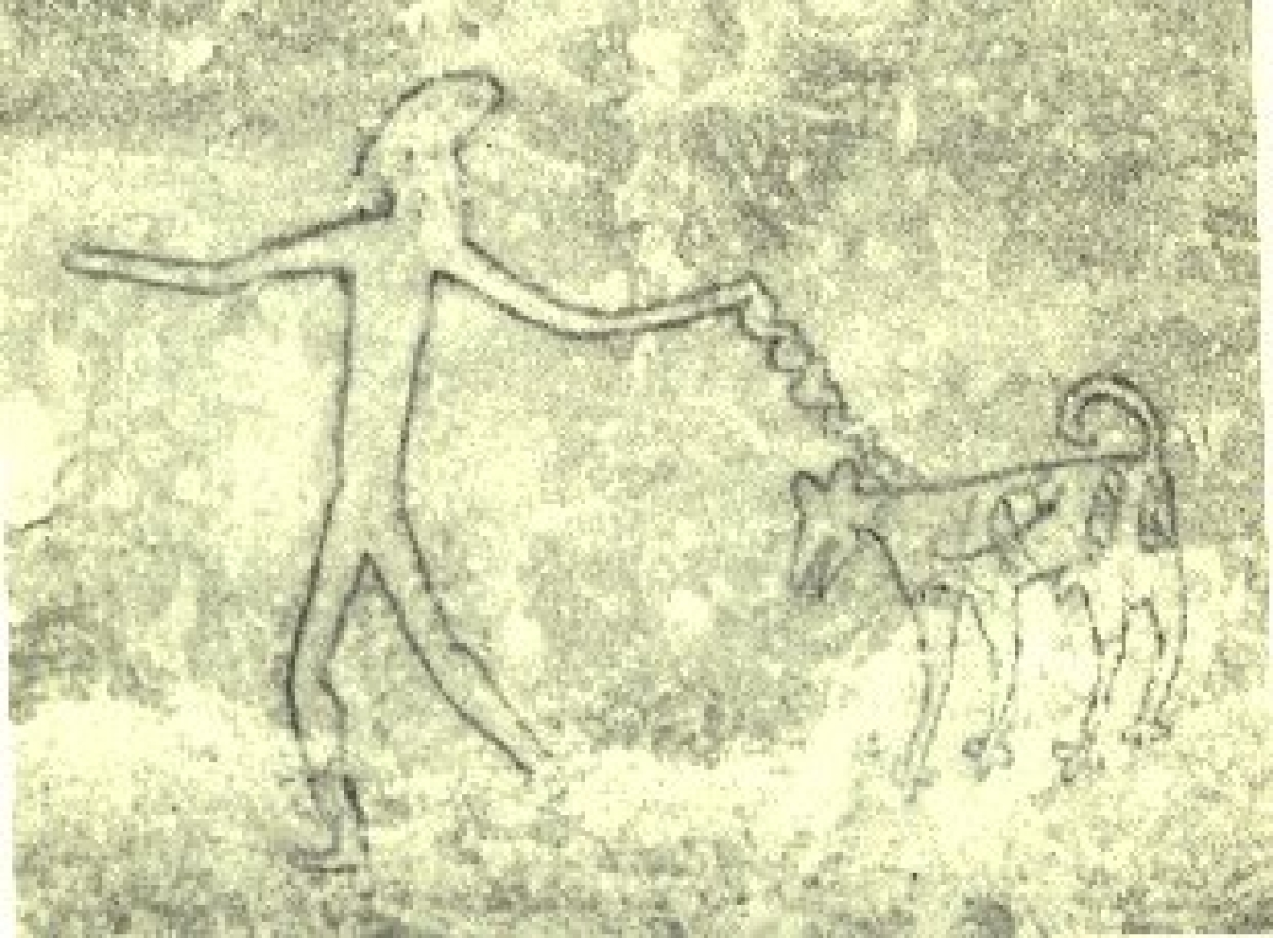 Bhimbetka rock painting of a man with a dog