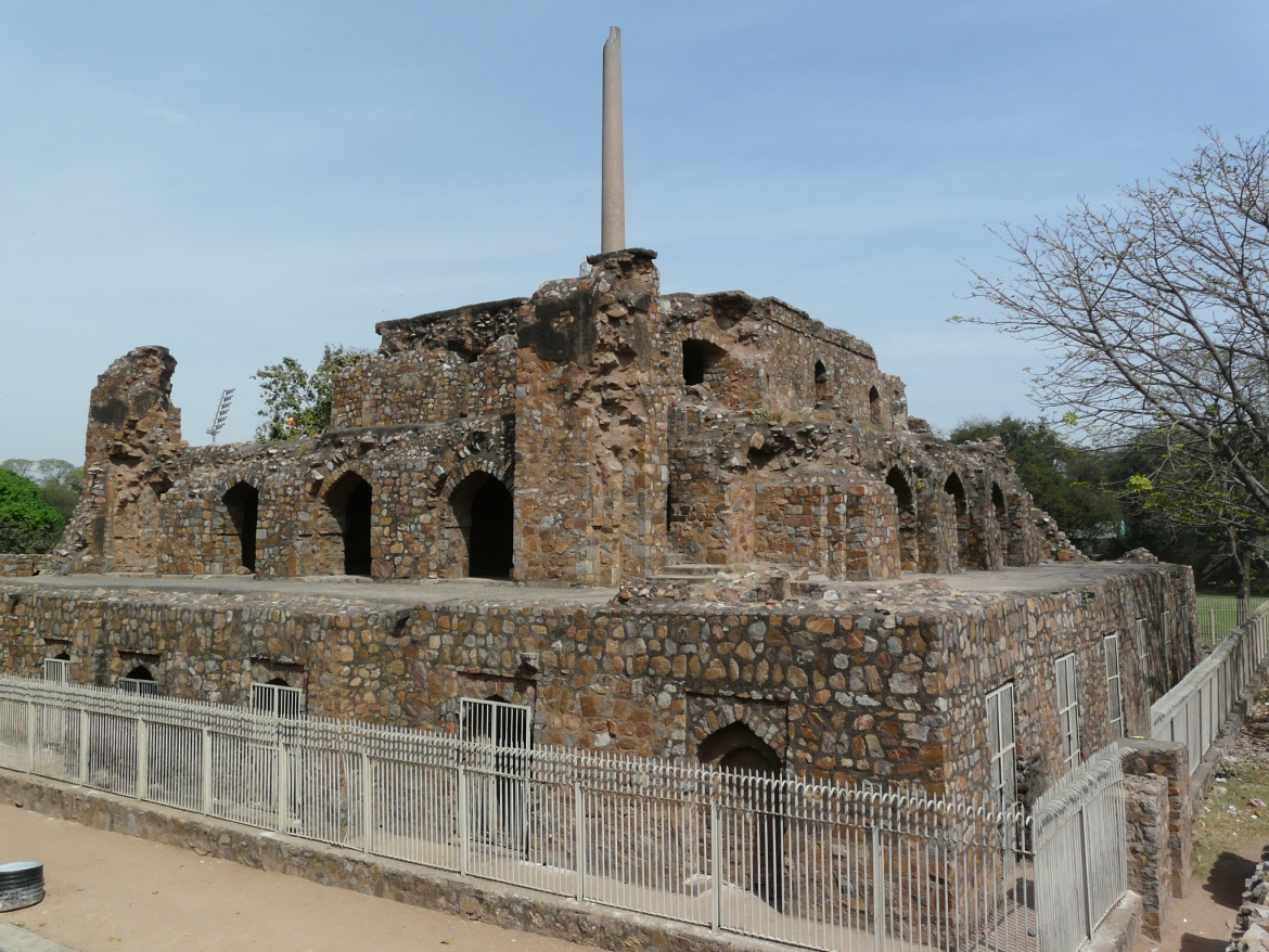 Ashokan Pillar at the palace ruins in Feroz Shah Kotla, called the Delhi-Topra pillar