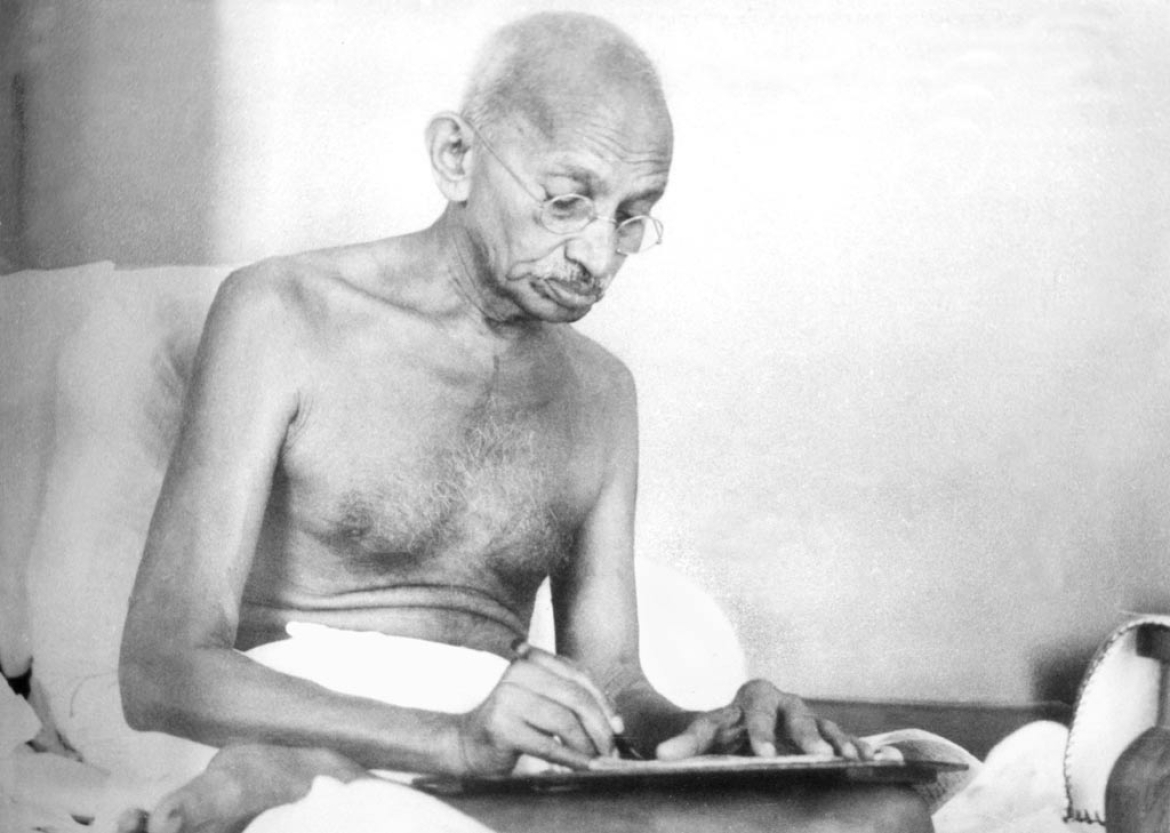 Gandhi writing a document