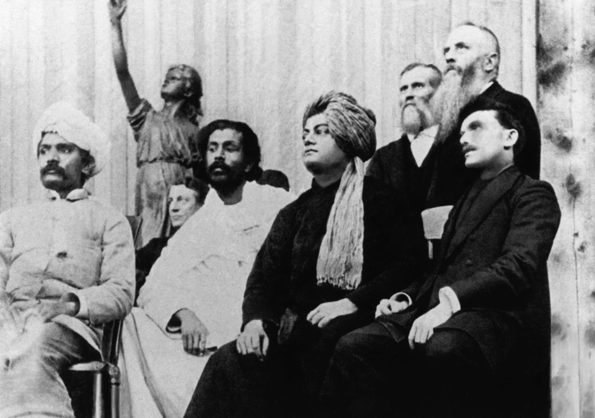 At the World Parliament of Religions, L-R: Virchand Gandhi, Hewivitarne Dharmapala, Swami Vivekananda, and (possibly) G. Bonet Maury