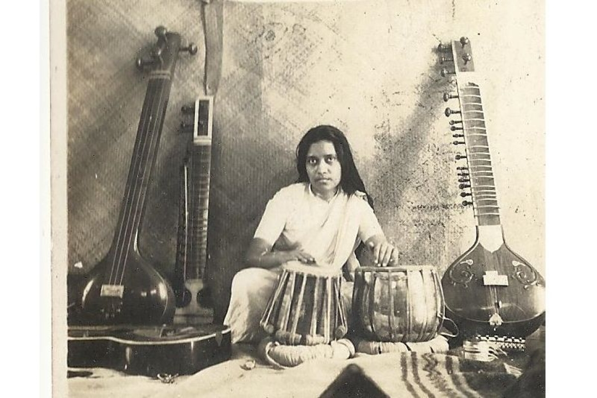 Dr. Purnima Sinha as a percussionist playing Tabla