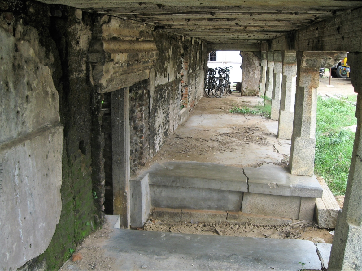 A portion of the outer colonnade still intact