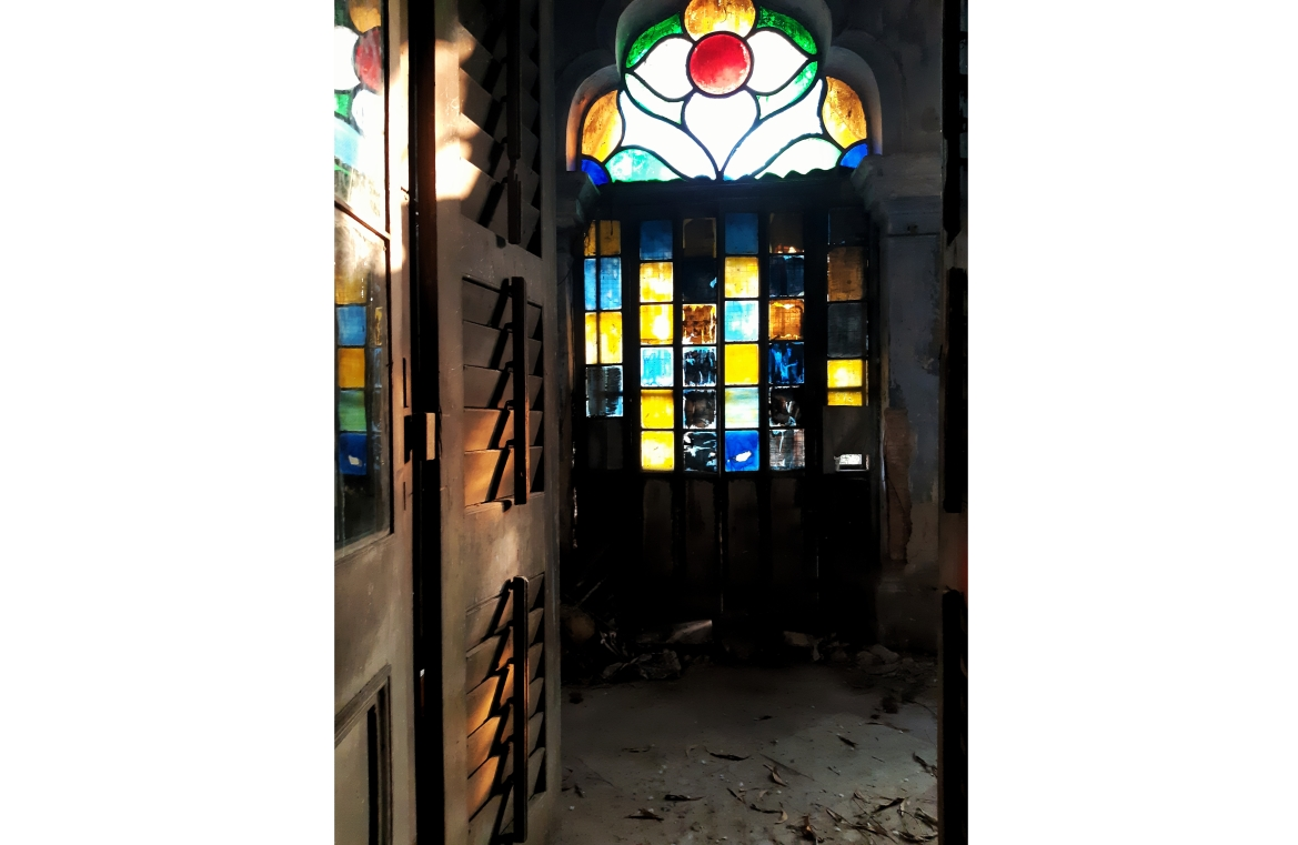 Uniquely-designed glass panels adorn some of the doors of Basu Bati