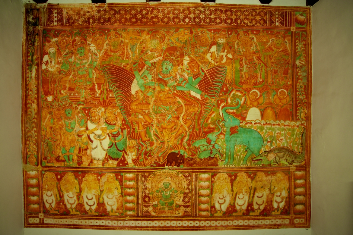 Mural depicting Gajendramoksham (an elephant saluting Lord Vishnu as the other gods, goddesses and sages look on in reverence) at the Krishnapuram Palace in Kayamkulam in Alappuzha district. This 154-sq ft painting is said to be the largest mural in Kerala. The Krishnapuram Palace was the residence of the rulers of the Kayamkulam Kingdom, whose chief deity is Vishnu.