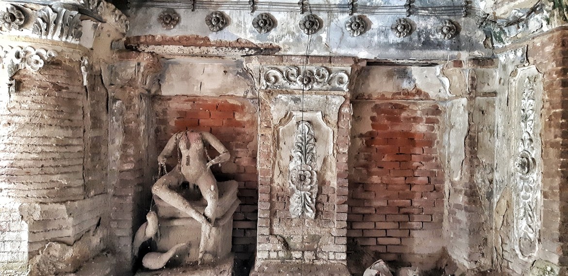 Remains of an intricately-carved sculpture at Basu Bati