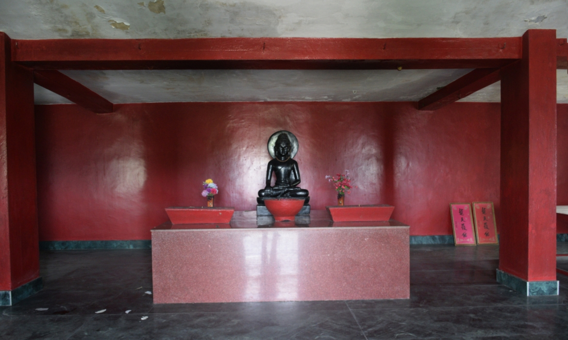 The statue of Buddha on the first floor of the temple